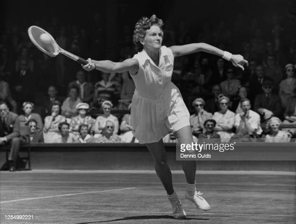 Beryl Penrose of Australia reaches to deliver a forehand return before losing 62 60 to eventual champion Louise Brough of the United States in their...