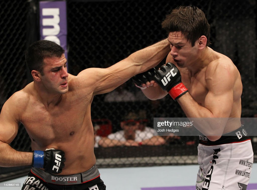 Besam Yousef punches Simeon Thoresen during their welterweight bout at the UFC on Fuel TV event at Ericsson Globe on April 14, 2012 in Stockholm, Sweden.