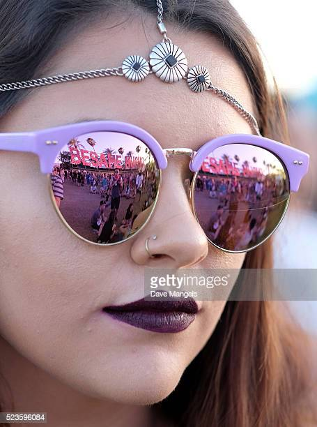 Besame Mucho art installation by R & R Studios is seen in the reflection of sunglasses during day 2 of the 2016 Coachella Valley Music & Arts...