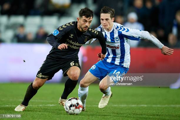 Besar Halimi of Brondby IF and Jens Jakob Thomasen of OB Odense in action during the Danish Superliga match between OB Odense and Brondby IF at...