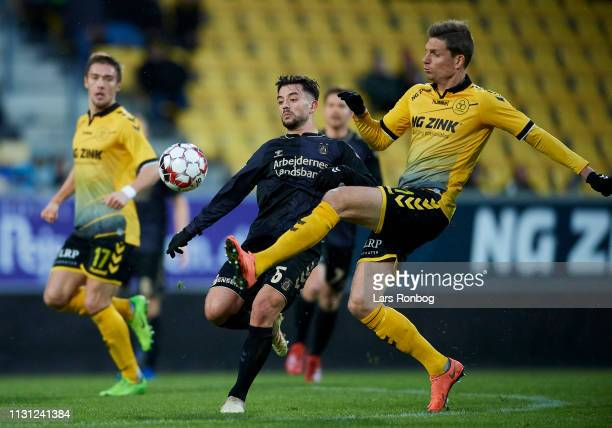 Besar Halimi of Brondby IF and Jonas Borring of AC Horsens compete for the ball during the Danish Superliga match between AC Horsens and Brondby IF...