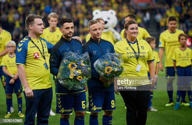 Besar Halimi of Brondby IF and Uffe Bech of Brondby IF receiving flowers prior to the Danish Superliga match between Brondby IF and FC Midtjylland at...