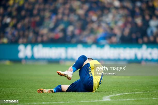Besar Halimi of Brondby IF get an injury during the Danish Superliga match between Brondby IF and FC Copenhagen at Brondby Stadion on November 04...