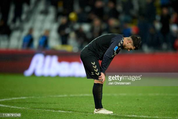 Besar Halimi of Brondby IF looks dejected after the Danish Superliga match between OB Odense and Brondby IF at Nature Energy Park on March 03 2019 in...