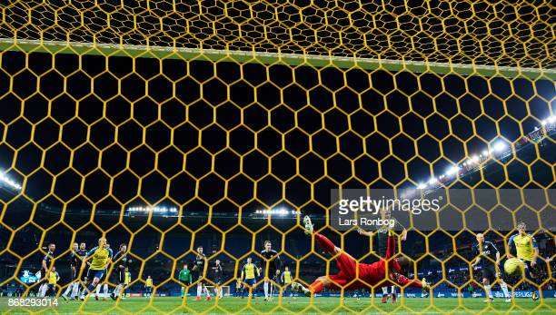 Besar Halimi of Brondby IF scores the 21 goal against Goalkeeper Hannes Thor Halldorsson of Randers FC during the Danish Alka Superliga match between...