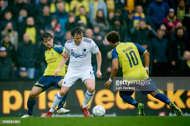 Besar Halimi of Brondby IF William Kvist of FC Copenhagen and Hany Mukhtar of Brondby IF compete for the ball during the Danish Alka Superliga match...