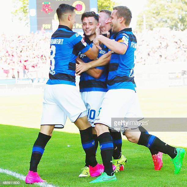 Besar Halimi of Frankfurt celebrates his team's first goal with team mates during the Second Bundesliga match between FSV Frankfurt and FC St. Pauli...