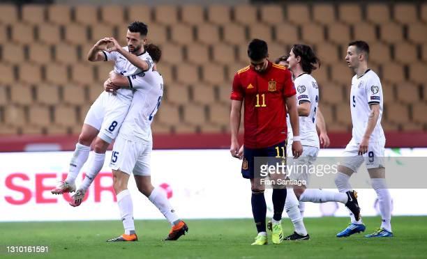 Besar Halimi of Kosovo celebrates scoring their team's first goal with teammate Mirgim Vojvoda during the FIFA World Cup 2022 Qatar qualifying match...