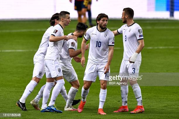 Besar Halimi of Kosovo celebrates with his teammates after scoring his side's first goal during the FIFA World Cup Qatar 2022 Qualifier between Spain...