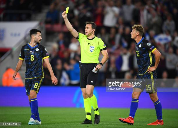 Besar Halimi of Kosovo is shown a yellow card from referee Felix Zwayer after arguing the penalty decision during the UEFA Euro 2020 qualifier match...