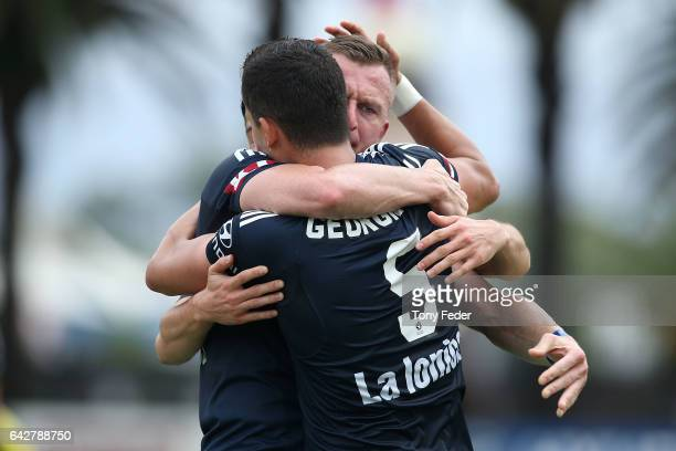 Besart Berisha and Daniel Georgievski of the Victory celebrate a goal during the round 22 A-League match between the Central Coast Mariners and...