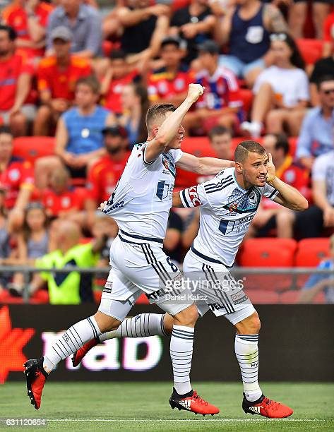 Besart Berisha and James Troisi of the Victory react after scoring during the round 14 ALeague match between Adelaide United and Melbourne Victory at...