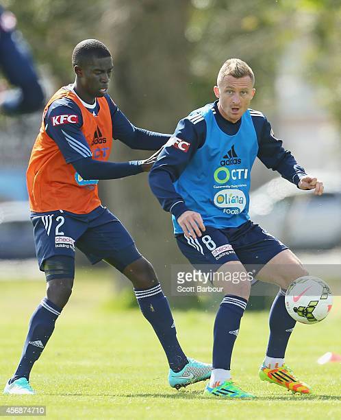 Besart Berisha and Jason Geria compete for the ball during a Melbourne Victory ALeague training session at Gosch's Paddock on October 9 2014 in...