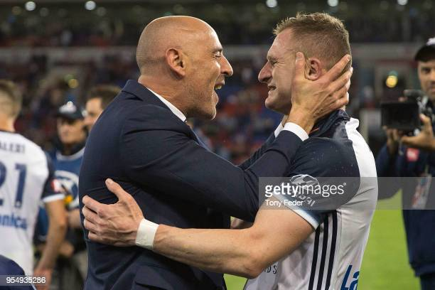 Besart Berisha and Kevin Muscat of the Victory celebrate the win over the Jets during the 2018 ALeague Grand Final match between the Newcastle Jets...