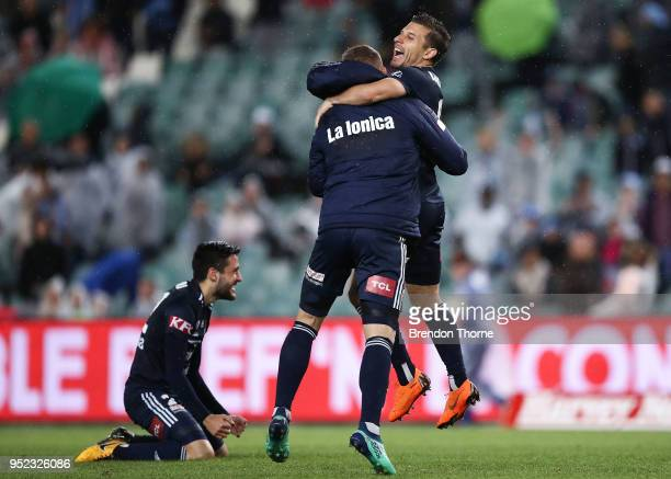 Besart Berisha and Kosta Barbarouses of the Victory celebrate at full time during the ALeague Semi Final match between Sydney FC and Melbourne...
