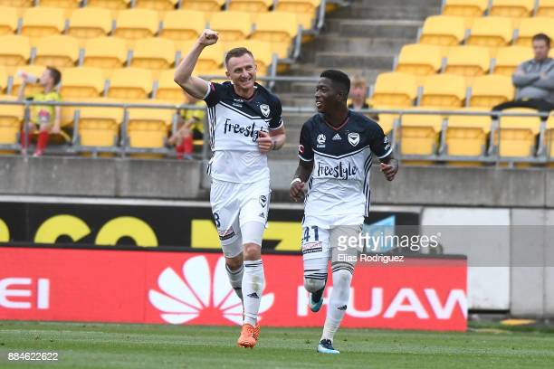 Besart Berisha and Leroy George of Melbourne Victory celebrate after scoring a goal during the round nine ALeague match between the Wellington...