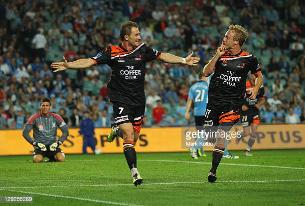 Besart Berisha and Mitch Nichols of the Roar celebrate after Berisha scored a goal during the round two ALeague match between Sydney FC and the...