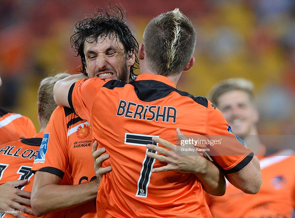 Besart Berisha (R) and Thomas Broich of the Roar celebrate a goal during the round 19 A-League match between the Brisbane Roar and the Central Coast Mariners at Suncorp Stadium on February 1, 2013 in Brisbane, Australia.