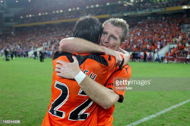 Besart Berisha and Thomas Broich of the Roar celebrate after winning the 2012 ALeague Grand Final match between the Brisbane Roar and the Perth Glory...