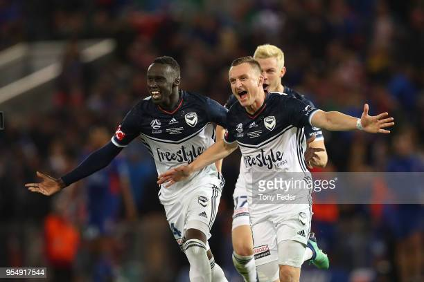 Besart Berisha and Thomas Deng of the Victory celebrate the win over the Jets during the 2018 ALeague Grand Final match between the Newcastle Jets...