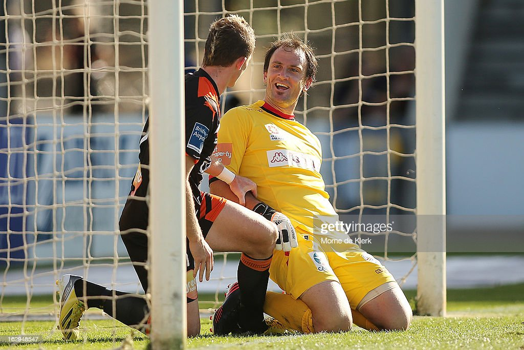 Besart Berisha of Brisbane and Eugene Galekovic of Adelaide talk in the goal mouth after Berisha nearly scored a goal during the round 23 A-League match between Adelaide United and the Brisbane Roar at Hindmarsh Stadium on March 2, 2013 in Adelaide, Australia.