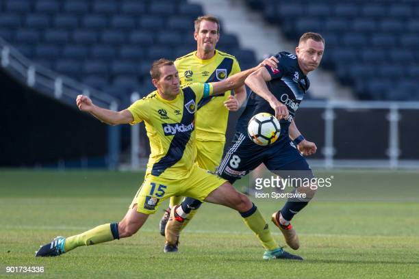 Besart Berisha of Melbourne Victory and Alan Baro of the Central Coast Mariners contest the ball during Round 14 of the Hyundai ALeague Series...