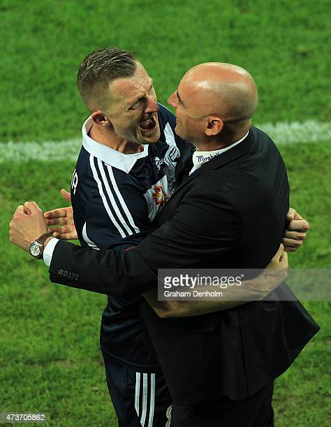 Besart Berisha of Melbourne Victory and Melbourne Victory Coach Kevin Muscat celebrate victory in the 2015 ALeague Grand Final match between the...