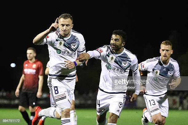 Besart Berisha of Melbourne Victory celebrates after scoring his sides first goal with Fahid Ben Khalfallah during the FFA Cup Round of 16 match...
