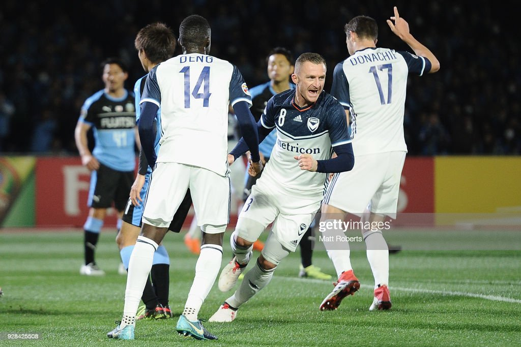 Besart Berisha #8 of Melbourne Victory celebrates scoring a goal during the AFC Champions League Group F match between Kawasaki Frontale and Melbourne Victory at Todoroki Stadium on March 7, 2018 in Kawasaki, Kanagawa, Japan.