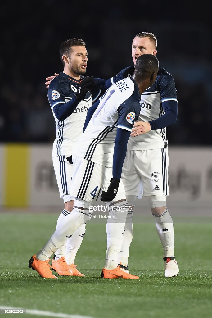 Besart Berisha #8 of Melbourne Victory celebrates scoring a goal with team mates during the AFC Champions League Group F match between Kawasaki Frontale and Melbourne Victory at Todoroki Stadium on March 7, 2018 in Kawasaki, Kanagawa, Japan.