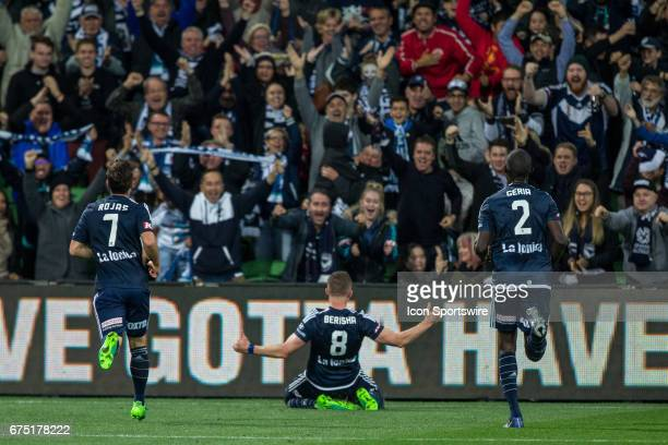 Besart Berisha of Melbourne Victory celebrates with the crowd with Marco Rojas of Melbourne Victory and Jason Geria of Melbourne Victory in tow...