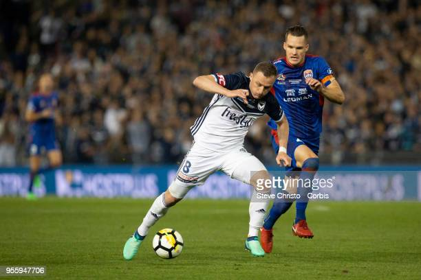 Besart Berisha of Melbourne Victory is challenged by Jets Nigel Boogaard during the 2018 ALeague Grand Final match between the Newcastle Jets and the...