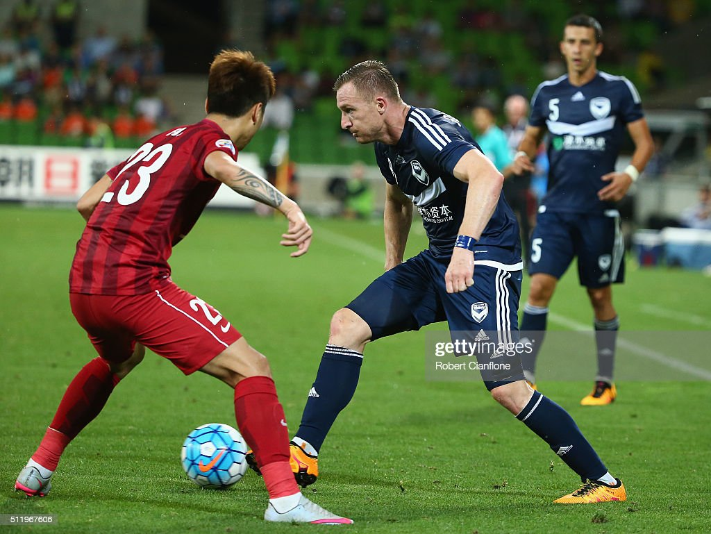Besart Berisha of Melbourne Victory looks to get past Huan Fu of Shanghai SIPG during the AFC Asian Champions League match between Melbourne Victory and Shanghai Sipg at AAMI Park on February 24, 2016 in Melbourne, Australia.