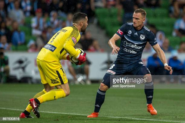 Besart Berisha of Melbourne Victory stares down Dean Bouzanis of Melbourne City after a failed attempt at goal during Round 12 of the Hyundai ALeague...