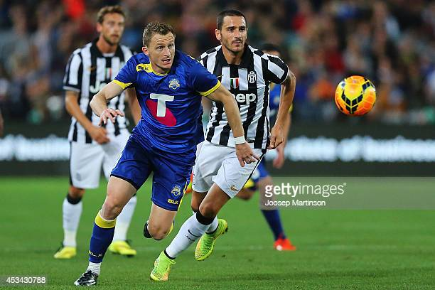 Besart Berisha of the All Stars beats the defence during the match between the ALeague All Stars and Juventus at ANZ Stadium on August 10 2014 in...