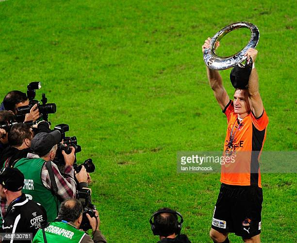Besart Berisha of the Brisbane Roar holds up the trophy after winning the 2014 A-League Grand Final match between the Brisbane Roar and the Western...