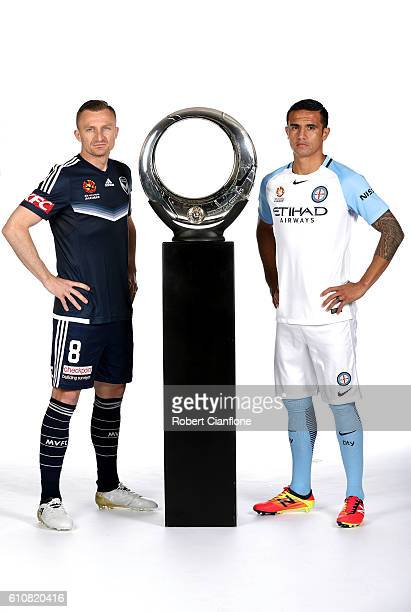 Besart Berisha of the Melbourne Victory and Tim Cahill of Melbourne City pose during the 206/17 ALeague media day at AAMI Park on September 28 2016...