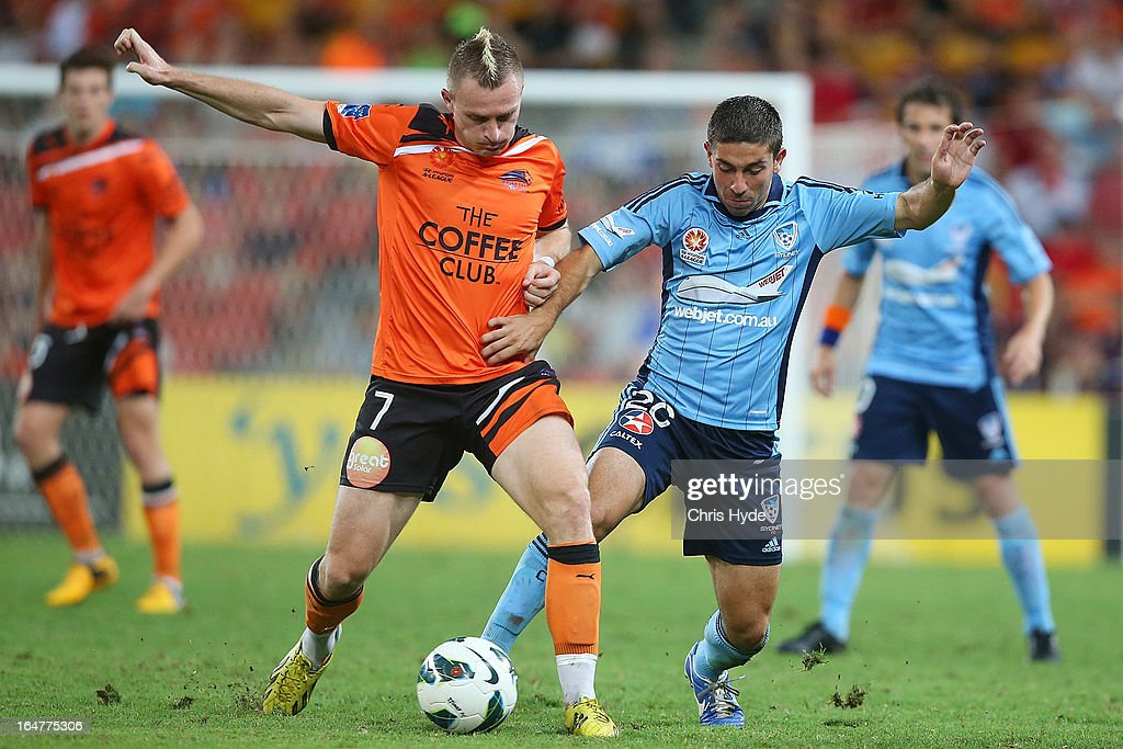 Besart Berisha of the Roar and Peter Triantis of Sydney FC ompete for the ball during the round 27 A-League match between the Brisbane Roar and Sydney FC at Suncorp Stadium on March 28, 2013 in Brisbane, Australia.
