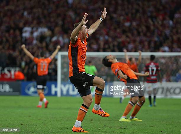 Besart Berisha of the Roar celebrates after the Roar defeated the Wanderers in extra time during the 2014 ALeague Grand Final match between the...
