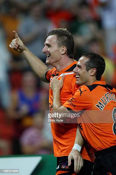 Besart Berisha of the Roar celebrates scoring a goal with team mate Massimo Murdocca during the round 20 ALeague match between the Brisbane Roar and...