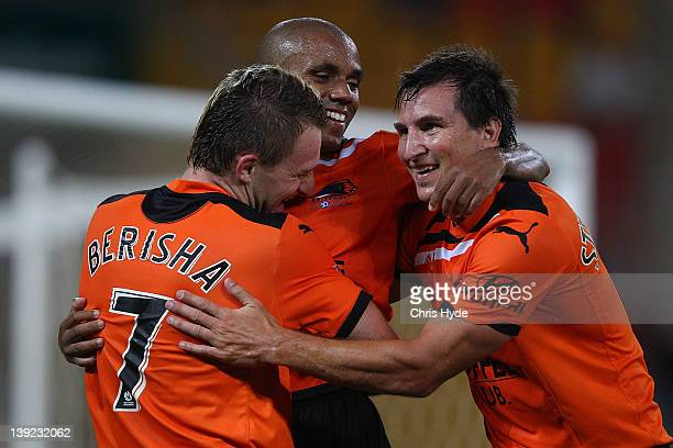 Besart Berisha of the Roar celebrates scoring his second goal with team mates Henrique and Shane Stefanutto during the round 20 ALeague match between...
