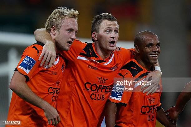Besart Berisha of the Roar celebrates scoring his second goal with team mates Mitchell Nichols and Henrique during the round 20 ALeague match between...