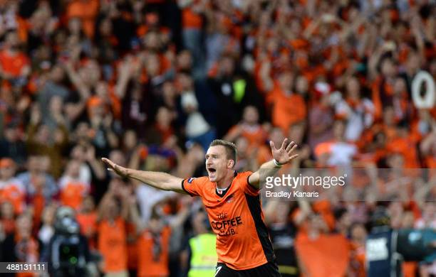 Besart Berisha of the Roar celebrates victory as the full time siren sounds after the 2014 A-League Grand Final match between the Brisbane Roar and...