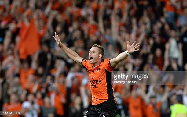 Besart Berisha of the Roar celebrates victory as the full time siren sounds after the 2014 ALeague Grand Final match between the Brisbane Roar and...