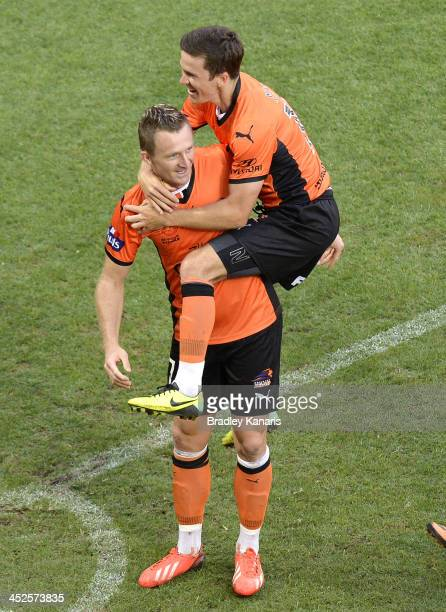 Besart Berisha of the Roar celebrates with team mate Matthew McKay during the round eight ALeague match between Brisbane Roar and Perth Glory at...