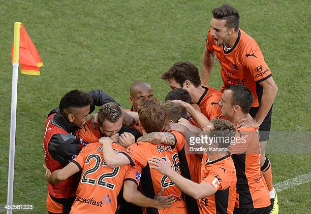 Besart Berisha of the Roar celebrates with team mates after scoring a goal during the round eight ALeague match between Brisbane Roar and Perth Glory...