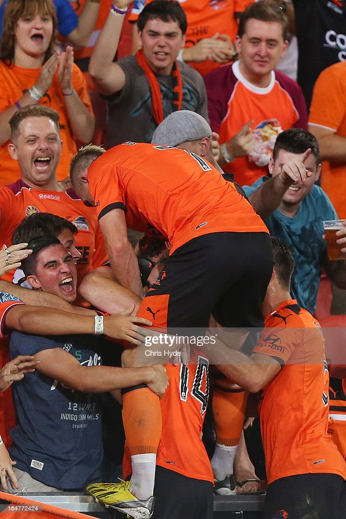 Besart Berisha of the Roar climbs ino the crowd after helping team mate Steven Lustica score a goal during the round 27 A-League match between the Brisbane Roar and Sydney FC at Suncorp Stadium on March 28, 2013 in Brisbane, Australia.