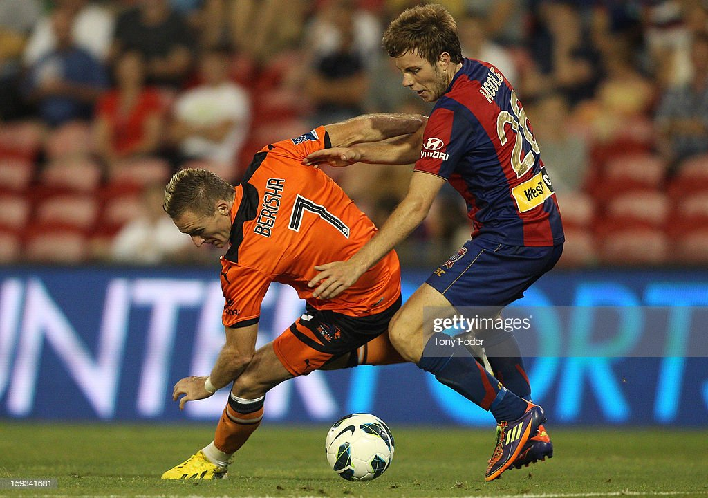 Besart Berisha of the Roar contests the ball with Andrew Hoole (R) of the Jets during the round 16 A-League match between the Newcastle Jets and the Brisbane Roar at Hunter Stadium on January 12, 2013 in Newcastle, Australia.