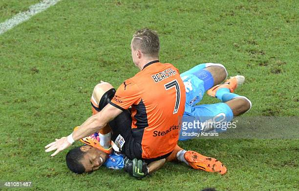 Besart Berisha of the Roar is given a red card by referee Chris Beath for this challenge on Robbie Wielaert of the Heart during the round 25 ALeague...
