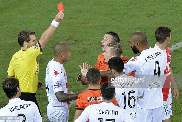 Besart Berisha of the Roar is given a red card by referee Chris Beath for his challenge on Robbie Wielaert of the Heart during the round 25 ALeague...